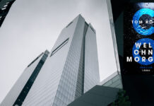 """Wolkenkratzer von unten betrachtet mit dem Buchcover """"CO2 - Welt ohne Morgen"""